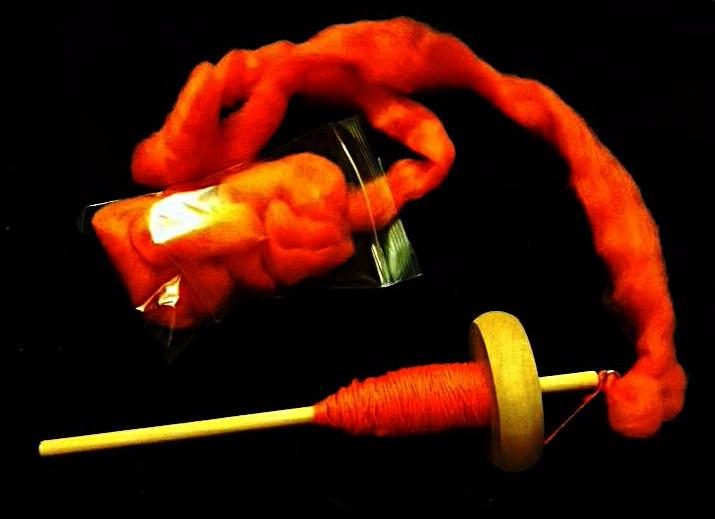 Yes, CJ likes orange yarn.